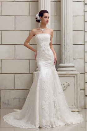25bee738 Cascading Ruffled Champagne Organza Wedding Ball Gown. $329. Glamorous ivory  lace and tulle mermaid floor length wedding dress